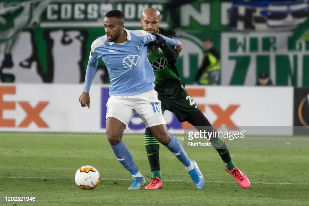John Anthony Brooks of Wolfsburg battle for the ball against Isaac Kiese Thelin of Malmö during the UEFA Europa League, last 32, first leg football...