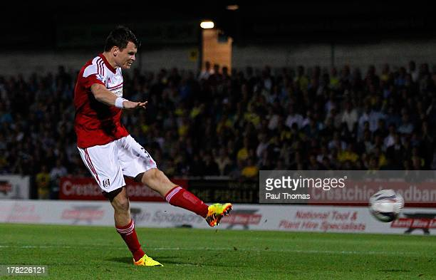 John Arne Riise of Fulham scores the winning goal in the penalty shootout during the Capital One Cup Second Round match between Burton Albion and...