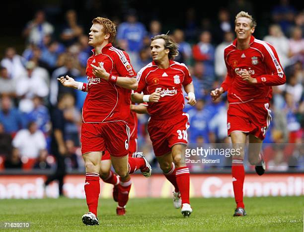 John Arne Riise of Liverpool celebrates after scoring the opening goal during the FA Community Shield match between Liverpool and Chelsea at the...