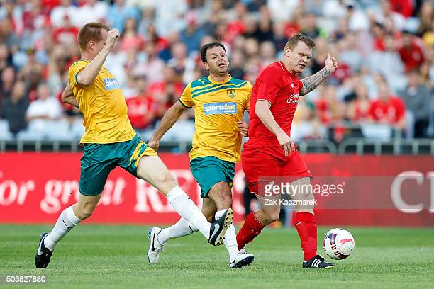 John Arne Riise of Liverpool FC Legends evades a challenge by Hayden Foxe of Australian Legends during the match between Liverpool FC Legends and the...