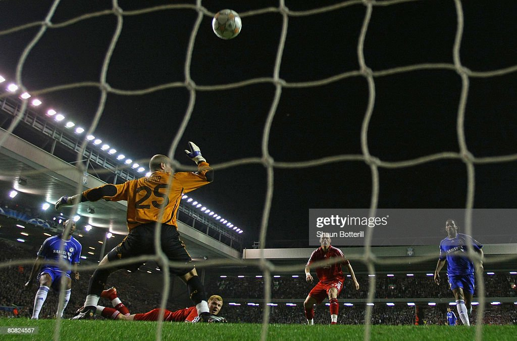 John Arne Riise of Liverpool scores an own goal past team mate Jose Reina during the UEFA Champions League Semi Final, first leg match between Liverpool and Chelsea at Anfield on April 22, 2008 in Liverpool, England.
