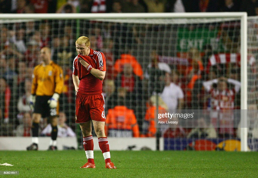 John Arne Riise of Liverpool shows his dejection after scoring an own goal during the UEFA Champions League Semi Final, first leg match between Liverpool and Chelsea at Anfield on April 22, 2008 in Liverpool, England.