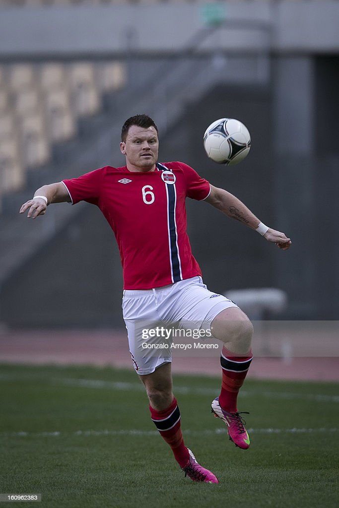 John Arne Riise of Norway controls the ball with during the international friendly football match between Norway and Ukraine at Estadio Olimpico de Sevilla on February 6, 2013 in Seville, Spain.
