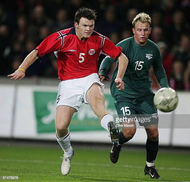 John Arne Riise of Norway gets away from Jalen Pokorn of Slovenia during the FIFA World Cup qualifying group five match between Norway and Slovenia...