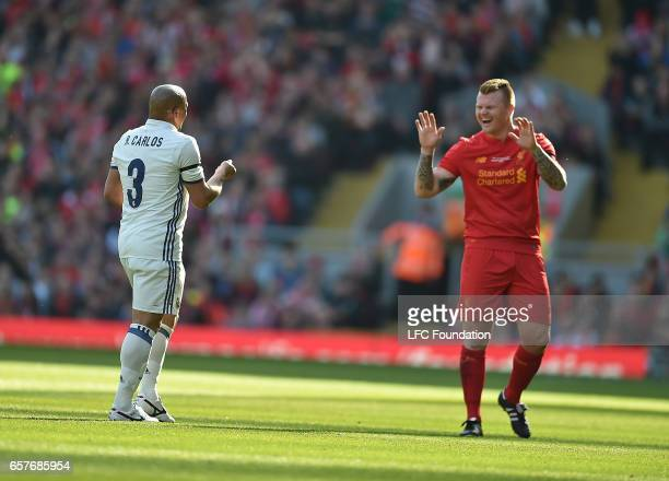 John Arne Risse of Liverpool with Roberto Carlos of Real Madrid Legends during the LFC Foundation Charity Match between Liverpool Legends and Real...