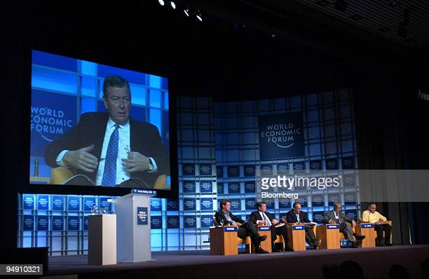 John Ashcroft United States Attorney General is seen on a screen during a panel discussion at the World Economic Forum in Davos Switzerland January...