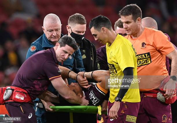 John Asiata of the Broncos is taken from the ground with an injury during the round 15 NRL match between the Brisbane Broncos and the South Sydney...