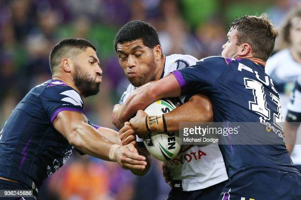 John Asiata of the Cowboys gets tackled by Jesse Bromwich of the Storm during the round three NRL match between the Melbourne Storm and the North...