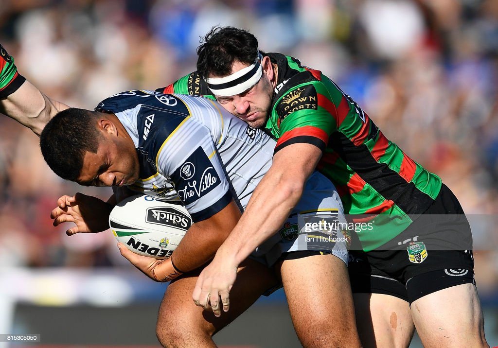 John Asiata of the Cowboys is tackled by David Tyrrell of the Rabbitohs during the round 19 NRL match between the South Sydney Rabbitohs and the North Queensland Cowboys at Barlow Park on July 16, 2017 in Cairns, Australia.