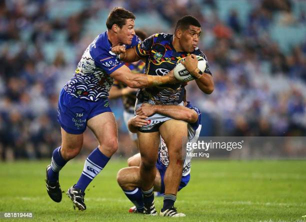 John Asiata of the Cowboys is tackled by Josh Jackson of the Bulldogs during the round 10 NRL match between the Canterbury Bulldogs and the North...