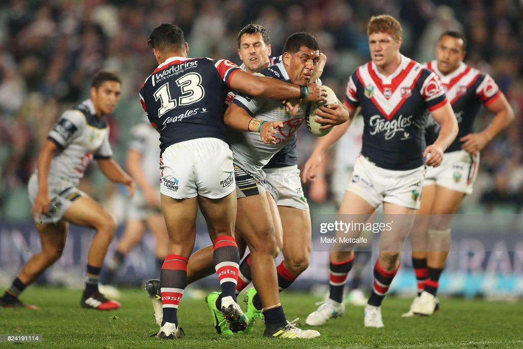 John Asiata of the Cowboys is tackled during the round 21 NRL match between the Sydney Roosters and the North Queensland Cowboys at Allianz Stadium on July 29, 2017 in Sydney, Australia.