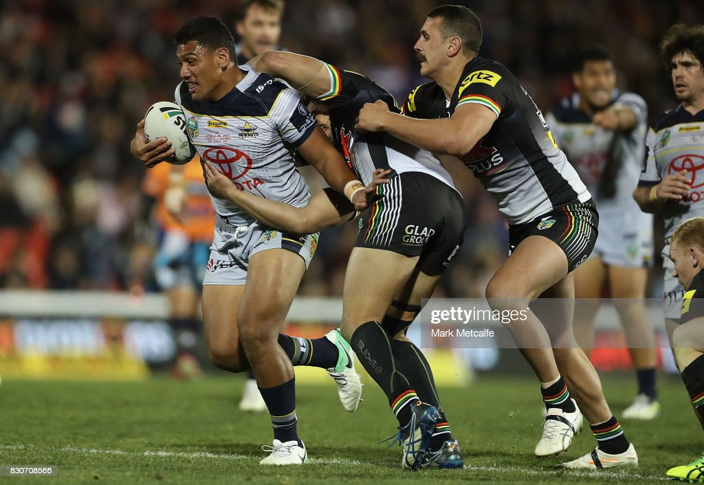 John Asiata of the Cowboys is tackled during the round 23 NRL match between the Penrith Panthers and the North Queensland Cowboys at Pepper Stadium on August 12, 2017 in Sydney, Australia.