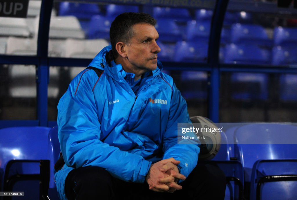 John Askey manager of Macclesfield Town looks on before the Vanarama National League match between Tranmere Rovers and Macclesfield Town at Prenton Park on February 20, 2018 in Birkenhead, England.
