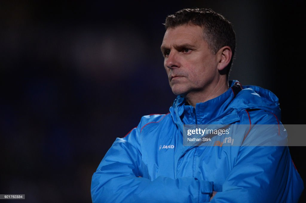 John Askey manager of Macclesfield Town looks on during the Vanarama National League match between Tranmere Rovers and Macclesfield Town at Prenton Park on February 20, 2018 in Birkenhead, England.