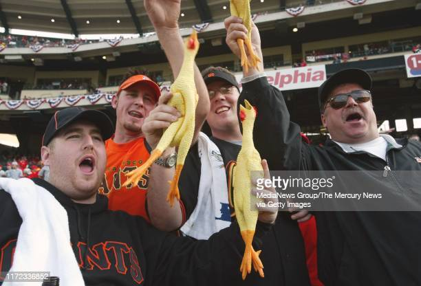 NEWS 10/14/02 John Auble Brian DoanJohn Howell and David Doan wave their rally chickens prior to game one All are from Santa Cruz Today was Game 1 of...