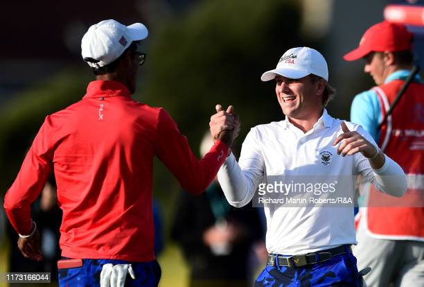 John Augenstein of the United States celebrates victory with teammate Akshay Bhatia following the singles matches during Day 2 of the Walker Cup at...