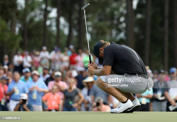 John Augenstein reacts after a putt on the 15th hole during the 119th USGA US Amateur Championship 36 hole final at Pinehurst Resort and Country Club...