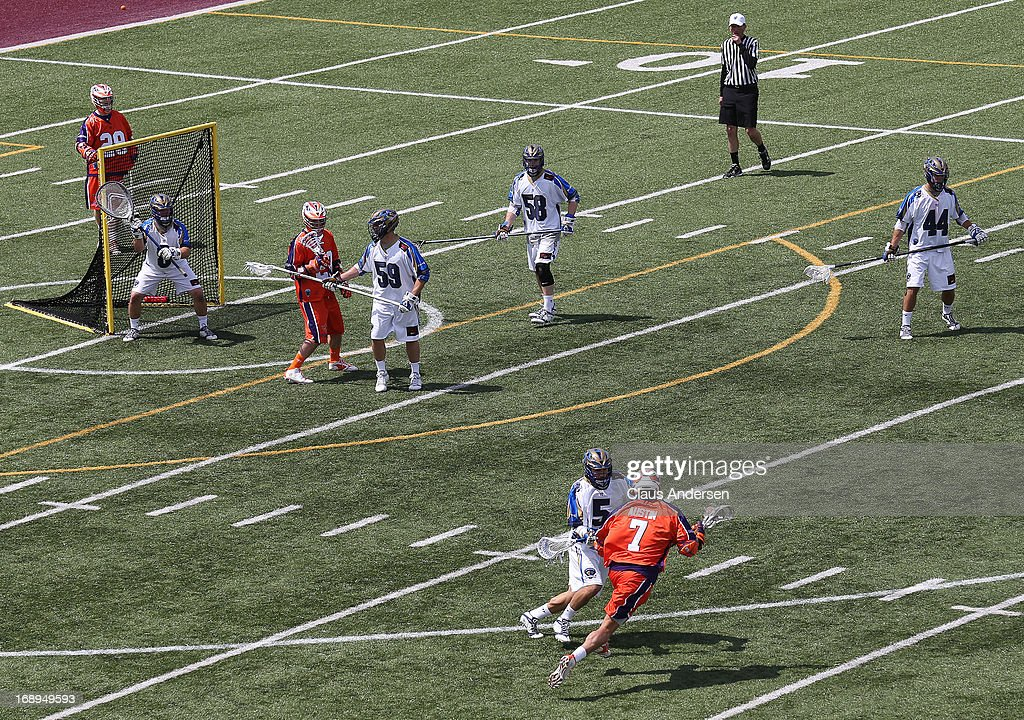 John Austin #7 of the Hamilton Nationals gets set to fire a shot against the Charlotte Hounds in a Major League Lacrosse game at Ron Joyce Stadium in Hamilton, Ontario, Canada. The Nationals defeated the Hounds 16-15 in overtime.
