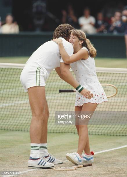 John Austin of the United States congratulates his sister Tracy Austin after defeating Mark Edmondson and Wendy Turnbull of Australia in the Mixed...