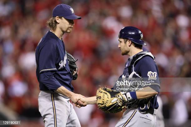 John Axford and Jonathan Lucroy of the Milwaukee Brewers celebrate after they won 42 against the St Louis Cardinals during Game 4 of the National...