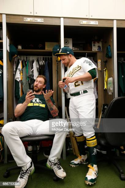 John Axford and Stephen Vogt of the Oakland Athletics talk in the clubhouse prior to the game against the Detroit Tigers at the Oakland Alameda...