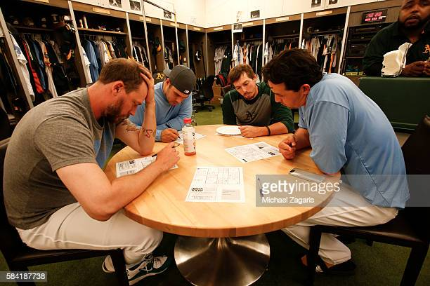 John Axford Josh Phegley Billy Burns and Fernando Rodriguez of the Oakland Athletics play sudoku in the clubhouse prior to the game against the Los...