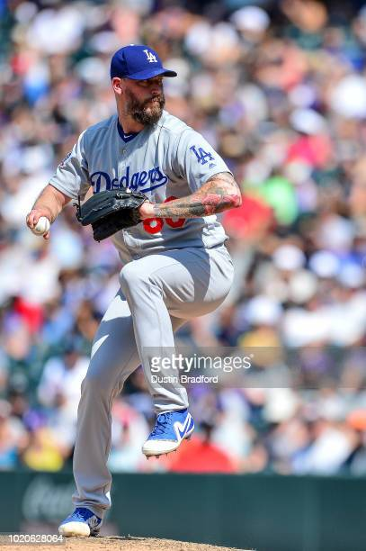 John Axford of the Los Angeles Dodgers pitches against the Colorado Rockies at Coors Field on August 12 2018 in Denver Colorado