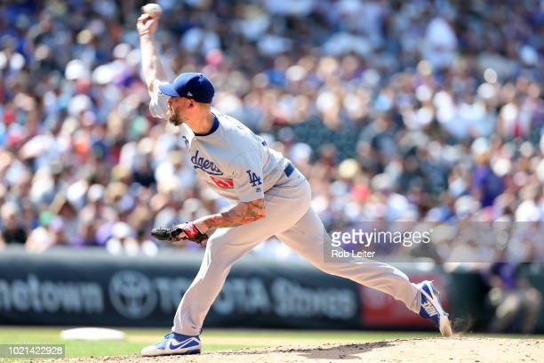 John Axford of the Los Angeles Dodgers pitches during the game against the Colorado Rockies at Coors Field on August 12 2018 in Denver Colorado The...