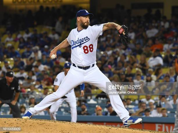 John Axford of the Los Angeles Dodgers pitches in the game against the Houston Astros at Dodger Stadium on August 4 2018 in Los Angeles California