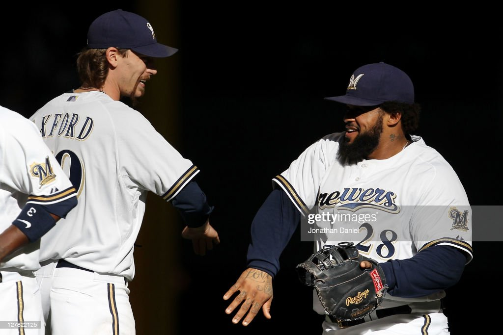 John Axford #59 of the Milwaukee Brewers and Prince Fielder #28 celebrate after their 4-1 win over the Arizona Diamondbacks in Game One of the National League Division Series at Miller Park on October 1, 2011 in Milwaukee, Wisconsin.