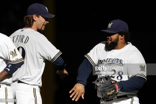 John Axford of the Milwaukee Brewers and Prince Fielder celebrate after their 41 win over the Arizona Diamondbacks in Game One of the National League...