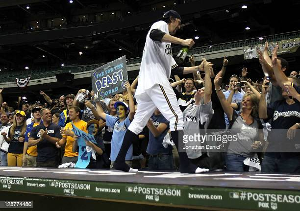 John Axford of the Milwaukee Brewers celebrates with fans after the Brewers 32 10 inning victory against the Arizona Diamondbacks in Game Five of the...