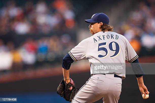 John Axford of the Milwaukee Brewers pitches during the game against the New York Mets at Citi Field on August 20 2011 in the Flushing neighborhood...