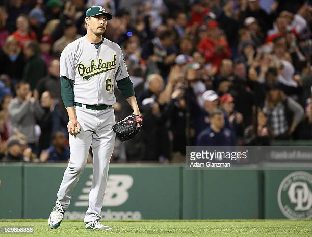 John Axford of the Oakland Athletics looks on after giving up a grand slam to Jackie Bradley Jr #25 of the Boston Red Sox in the sixth inning during...