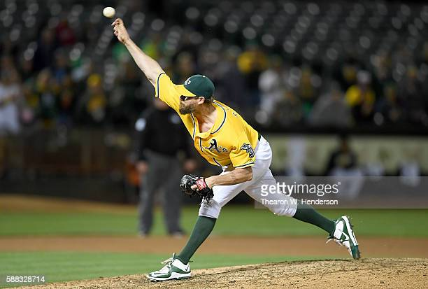 John Axford of the Oakland Athletics pitches against the Baltimore Orioles in the top of the ninth inning at the Oakland Coliseum on August 10 2016...