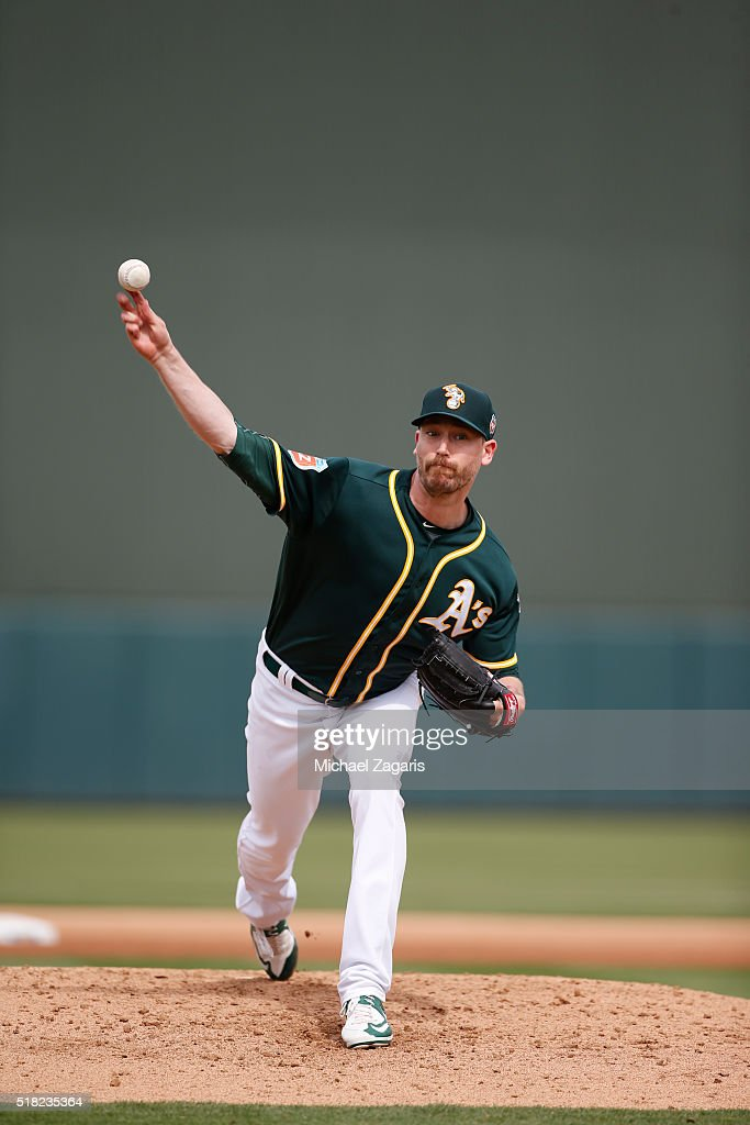John Axford #61 of the Oakland Athletics pitches during a spring training game against the Kansas City Royals at Hohokam Stadium on March 7, 2016 in Mesa, Arizona.