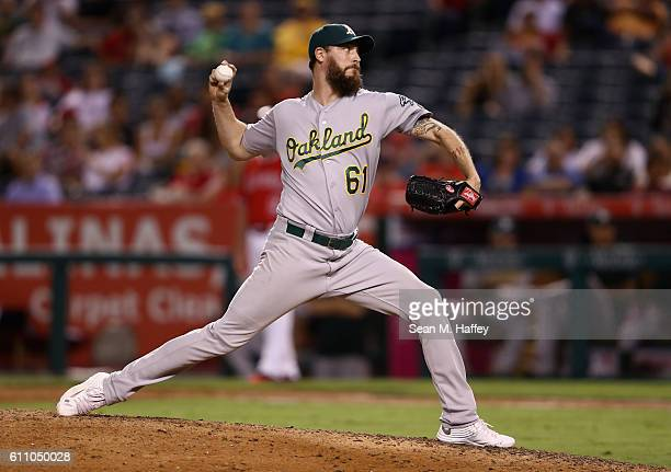 John Axford of the Oakland Athletics pitches during the eighth inning of a game against the Los Angeles Angels of Anaheim at Angel Stadium of Anaheim...