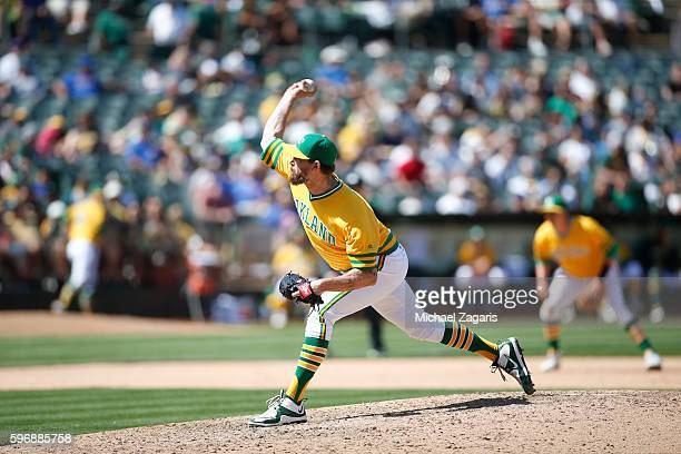 John Axford of the Oakland Athletics pitches during the game against the Chicago Cubs at the Oakland Coliseum on August 6 2016 in Oakland California...