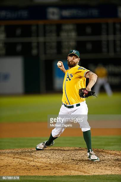 John Axford of the Oakland Athletics pitches during the game against the Baltimore Orioles at the Oakland Coliseum on August 10 2016 in Oakland...