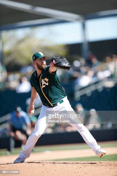 John Axford of the Oakland Athletics pitches during the game against the Texas Rangers at Hohokam Stadium on March 2 2017 in Mesa Arizona