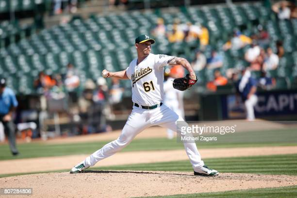 John Axford of the Oakland Athletics pitches during the game against the Houston Astros at the Oakland Alameda Coliseum on June 22 2017 in Oakland...