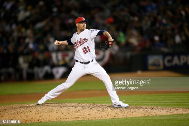 John Axford of the Oakland Athletics pitches during the game against the Chicago White Sox at the Oakland Alameda Coliseum on July 3 2017 in Oakland...