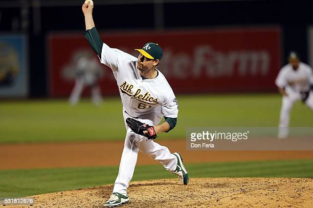 John Axford of the Oakland Athletics pitches in the top of the eighth inning against the Texas Rangers at Oco Coliseum on May 16 2016 in Oakland...