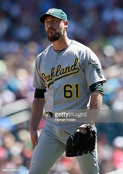 John Axford of the Oakland Athletics reacts to walking Max Kepler of the Minnesota Twins with the bases loaded during the seventh inning of the game...
