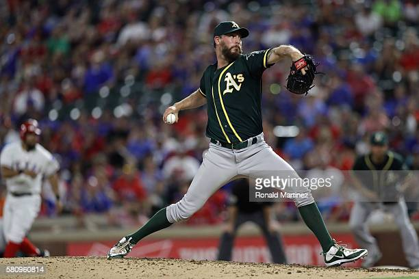 John Axford of the Oakland Athletics throws against the Texas Rangers in the seventh inning at Globe Life Park in Arlington on July 25 2016 in...
