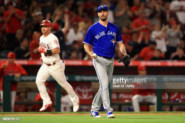 John Axford of the Toronto Blue Jays looks on after giving up a tworun homerun to Kole Calhoun of the Los Angeles Angels of Anaheim during the fourth...
