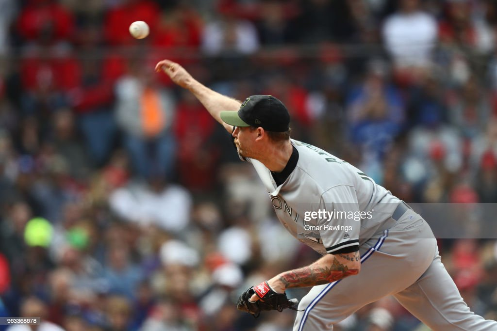 John Axford #77 of the Toronto Blue Jays pitches in the bottom of the seventh inning of the game against the Boston Red Sox at Fenway Park on May 28, 2018 in Boston, Massachusetts. MLB Players across the league are wearing special uniforms to commemorate Memorial Day.