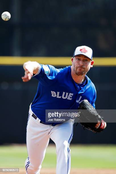 John Axford of the Toronto Blue Jays throws a warm up pitch prior to the third inning of a Grapefruit League spring training game against the New...