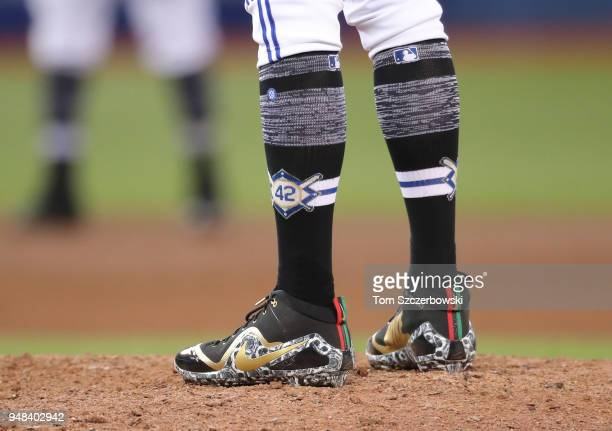 John Axford of the Toronto Blue Jays wears socks to honor Jackie Robinson during MLB game action against the Kansas City Royals at Rogers Centre on...