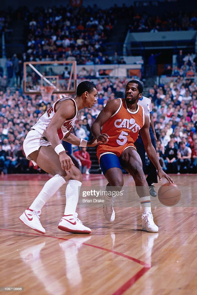 John Bagley Of The Cleveland Cavaliers Dribbles Against Darnell Valentine  Of The Portland Traiblazers During A